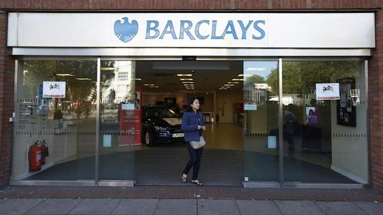A woman leaves the Swiss Cottage branch of Barclays in London September 20, 2013.