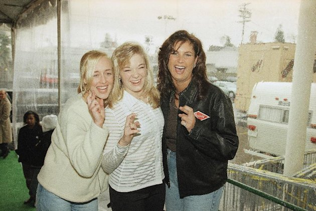 FILE - In this Jan. 26, 1997 file photo, country music singers Mindy McCready, left, LeAnn Rimes and Terri Clark joke around after a rehearsal for the American Music Awards at the Shrine Auditorium in
