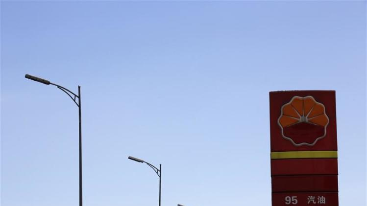 The PetroChina company logo is seen next to street lamps at its gas station in Beijing