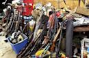 Stacks of guns are seen in a garage belonging to Brent Nicholson in Pageland, South Carolina