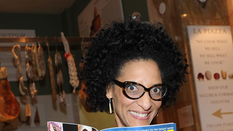 Carla Hall, of The Chew, helps celebrate her co-host Mario Batali's stint as guest editor of the April issue of FOOD & WINE during a party at Eataly, Wednesday, March 6, 2013, in New York.  (Photo by Diane Bondareff/Invision for FOOD & WINE/AP Images)