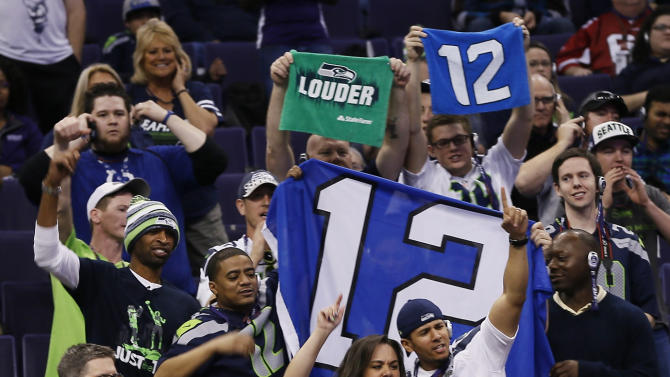 Seattle Seahawks fans cheer during media day for NFL Super Bowl XLIX football game Tuesday, Jan. 27, 2015, in Phoenix