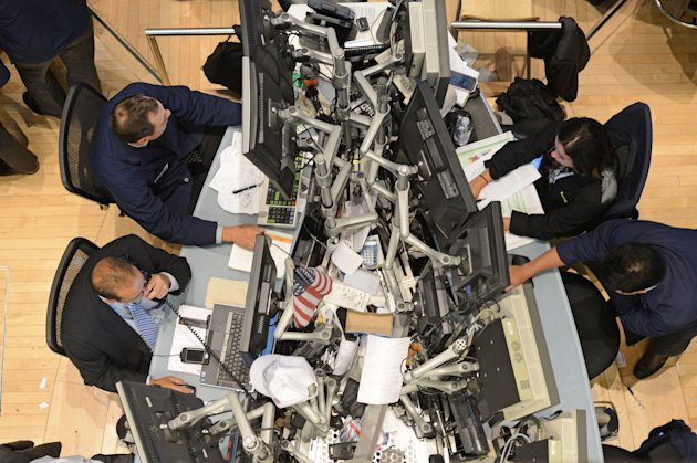 Traders work on the floor of the New York Stock Exchange in New York on Monday, July 23, 2012. (AP Photo/Henny Ray Abrams)