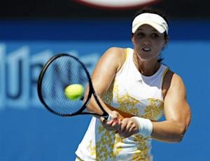 Laura Robson of Britain hits a return to Kirsten Flipkens of Belgium during their women's singles match at the Australian Open 2014 tennis tournament in Melbourne