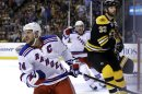 New York Rangers right wing Ryan Callahan (24) celebrates his goal and center Derek Stepan cheers from behind as Boston Bruins defenseman Zdeno Chara (33) reacts during the first period in Game 2 of the NHL Eastern Conference semifinal hockey playoff series in Boston, Sunday, May 19, 2013. (AP Photo/Elise Amendola)