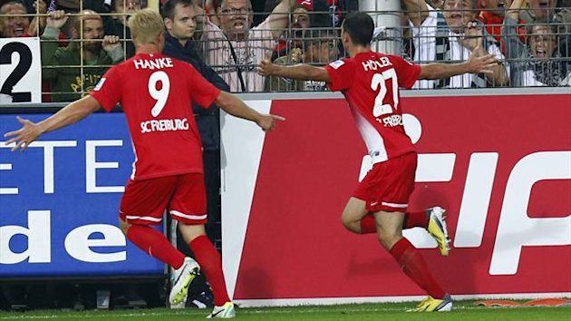 Freiburg's Nicolas Hoefler (R) and Mike Hanke celebrate Hoefler's goal against Bayern Munich (Reuters)