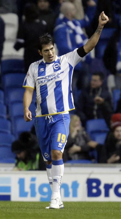 Brighton and Hove Albion's Leonardo Ulloa celebrates his goal against Hull City during their English FA Cup soccer match in Brighton