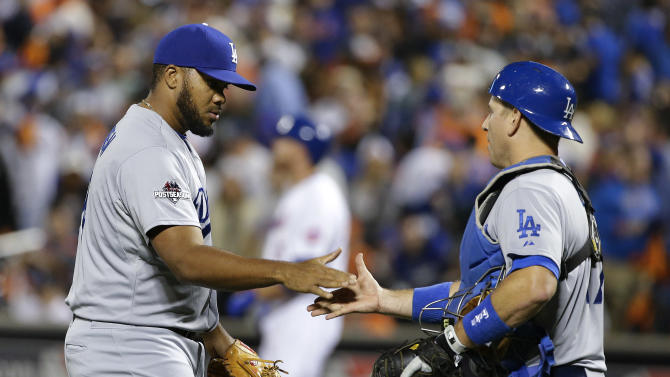 Los Angeles Dodgers pitcher Kenley Jansen, left, greets Los Angeles Dodgers catcher A.J. Ellis (17) after the Dodgers beat the New York Mets 3-1 in baseball's Game 4 of the National League Division Series, Tuesday, Oct. 13, 2015, in New York. (AP Photo/Frank Franklin II)