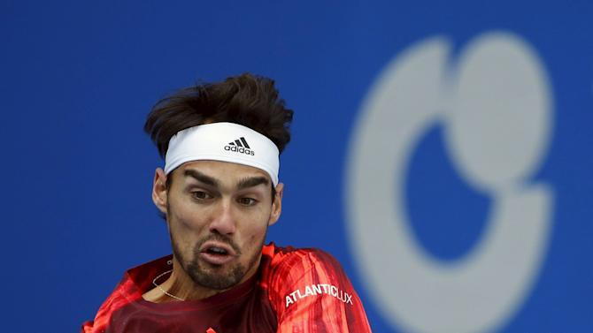 Fognini hits a return against Nadal during their men's single semifinal match at the China Open tennis tournament in Beijing