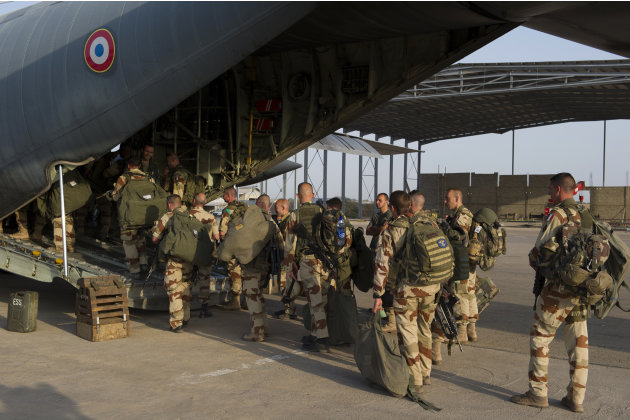 This picture released by the French Army Communications Audiovisual office (ECPAD) shows French soldiers of the 21st Marine Infantry Regiment boarding to Bamako, the capital from Mali, at the N'Djamen