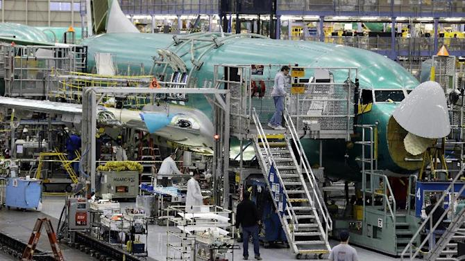 FILE- Workers assemble a Boeing Co. next-generation 737 airplane, in this file photo dated Tuesday, Jan. 29, 2013, at the company's 737 assembly facility in Renton, Washington, USA.  It is announced Tuesday March 19, 2013, that Ryanair is buying 175 Boeing 737-800 Next Generation aircraft in the biggest-ever order of Boeings by a European airline, in a major boost for the U.S. aerospace giant. (AP Photo/Ted S. Warren, File)