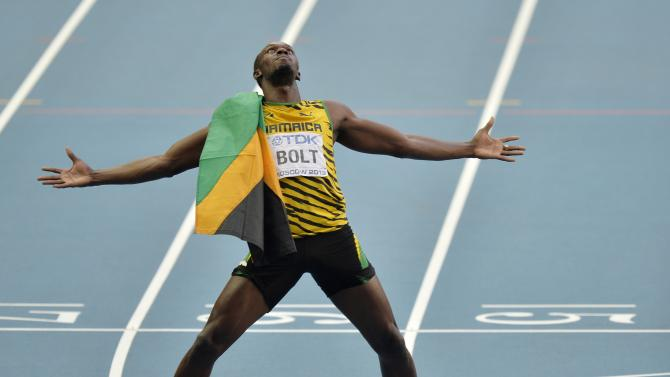 Jamaica's Usain Bolt celebrates winning gold in the men's 200-meter final at the World Athletics Championships in the Luzhniki stadium in Moscow, Russia, Saturday, Aug. 17, 2013. (AP Photo/Martin Meissner)