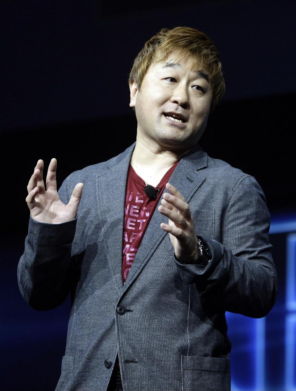 Yoshinori Ono, of Capcom, speaks during a news conference to announce the Sony Playstation 4 Wednesday, Feb. 20, 2013, in New York. (AP Photo/Frank Franklin II)