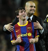 Barcelona&#39;s coach Josep Guardiola (right) celebrates with Argentinian forward Lionel Messi after the Champions League semi-final second leg football match between Barcelona and Real Madrid at the Camp Nou stadium in Barcelona on May 3, 2011. Guardiola, architect of one the greatest eras in the club&#39;s history, has reportedly told players he is leaving at the end of this season