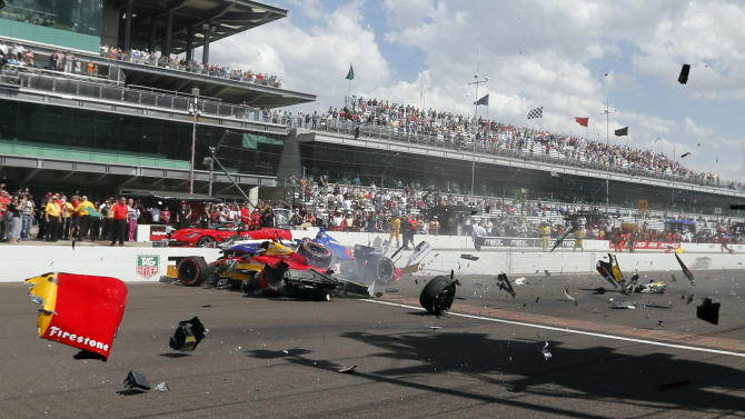 Sebastian Saavedra, left, of Colombia,  is hit by Mikhail Aleshin, of Russia,  at the start of the inaugural Grand Prix of Indianapolis IndyCar auto race at the Indianapolis Motor Speedway in Indianapolis, Saturday, May 10, 2014