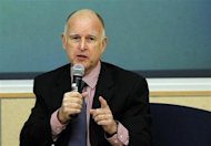 California Governor Jerry Brown gestures while addressing the audience during a summit meeting on the future of housing in California, in Oakland, California February 12, 2013. REUTERS/Robert Galbraith (