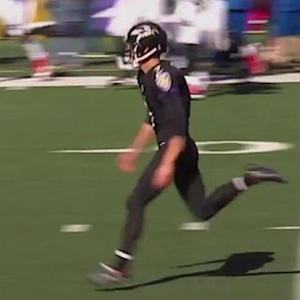 Baltimore Ravens kicker Justin Tucker goes for the photo finish