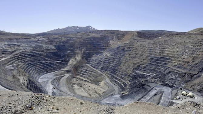 """FILE - This April 4, 2012 file photo shows the Newmont Gold Quarry pit in Battle Mountain, Nev. While the U.S. government reaps billions of dollars in royalties each year from fossil fuels extracted from federal public lands and waters, it does not collect any royalties from gold, uranium or other metals mined from the same lands, Congressional auditors reported Wednesday Dec. 12, 2012. A Government Accountability Office report found that the federal government doesn't even know how much these so-called """"hard rock"""" mines produce from federal public lands in 12 Western states _ where most of the mining occurs. (AP Photo/The Reno Gazette-Journal, David B. Parker, file)  NEVADA APPEAL OUT; NO SALES"""