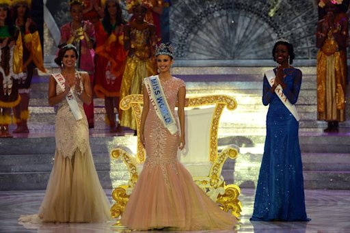 The new Miss World, Megan Young (C), from the Philippines stands after winning the crown during the Miss World 2013 finals in Nusa Dua, on Indonesia's resort island of Bali on September 28, 2013