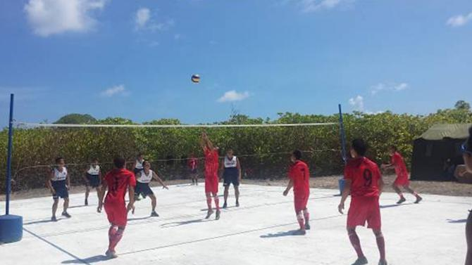 Vietnamese and Filipino troops play volleyball during their Friendship Games at Northeast Cay in the disputed South China Sea