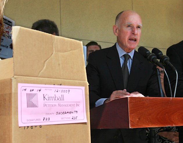 Gov. Jerry Brown discusses his tax-hike initiative before submitting the petitions for the initiative to the Sacramento County Registrar of Voters in Sacramento, Calif., Thursday, May 10, 2012.  Brown