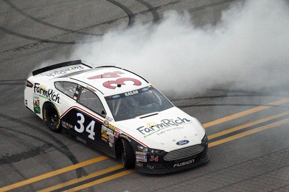 David Ragan burns out his tires following a win in the NASCAR Sprint Cup Series Aaron's 499 auto race at Talladega Superspeedway in Talladega, Ala., Sunday, May 5, 2013. (AP Photo/Butch Dill)