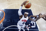 USA's Lebron James (6) grabs a rebound during the first half of a preliminary men's basketball game against France at the 2012 Summer Olympics, Sunday, July 29, 2012, in London. (AP Photo/Eric Gay, pool)