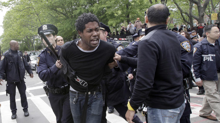 Police officers arrest an Occupy Wall Street activist during a march, Tuesday, May 1, 2012 in New York. Hundreds of activists with a variety of causes spread out over New York City on International Workers Day, or May Day, with Occupy Wall Street members leading a charge against financial institutions. (AP Photo/Mary Altaffer)