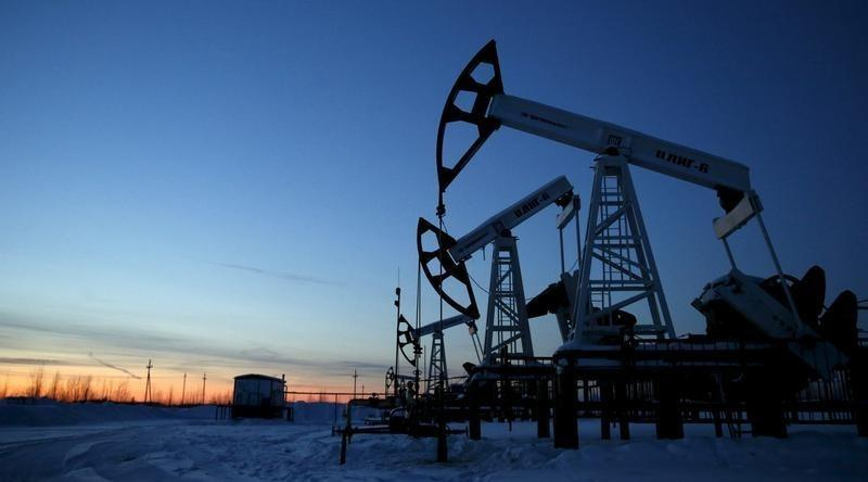 U.S. oil hits 12-year low on stockpile surge, risk aversion