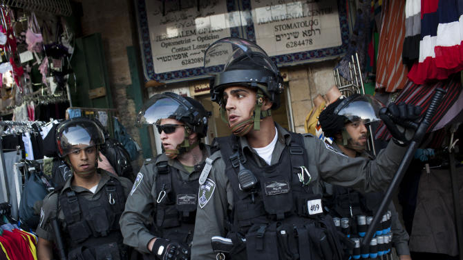 Israeli Border Police take position during clashes in Jerusalem's Old City, Tuesday, April 2, 2013. Clashes erupted during a protest in support of Maysara Abu Hamdiyeh, 64, who was serving a life sentence for his role in a foiled attempt to bomb a busy cafe in Jerusalem in 2002, and died Tuesday of cancer in an Israeli jail. Tensions are high in Israeli lockups where thousands of Palestinian security prisoners are being held. (AP Photo/Bernat Armangue)