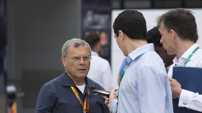 In this photo dated Sunday, July 5, 2015, Businessman Martin Sorrell is seen in the paddock area before the British Formula One Grand Prix at Silverstone circuit, Silverstone, England.  Chief executive of advertising giant WPP. Sorrell told The Associated Press on Sunday that public disputes over the state of F1 could in fact help to make the sport more commercially attractive, while noting that changes will help the sport market itself to new advertisers. (AP Photo/Jon Super)