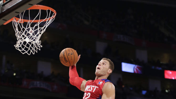West Team's Blake Griffin of the Los Angeles Clippers goes up for a basket during the first half of the NBA All-Star basketball game Sunday, Feb. 17, 2013, in Houston. (AP Photo/Eric Gay)