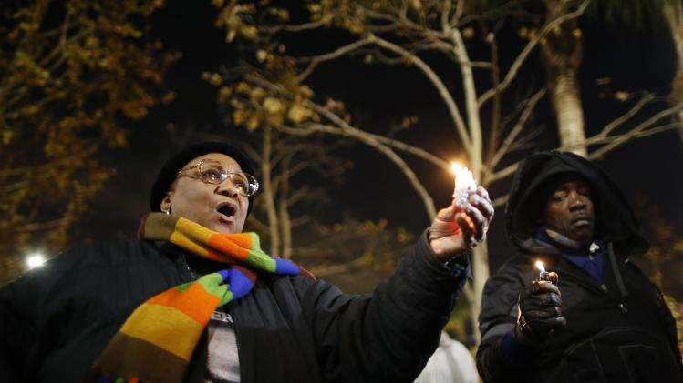 Gracie Taylor participates in a candlelight vigil in memoriam of Nelson Mandela's death, in Los Angeles