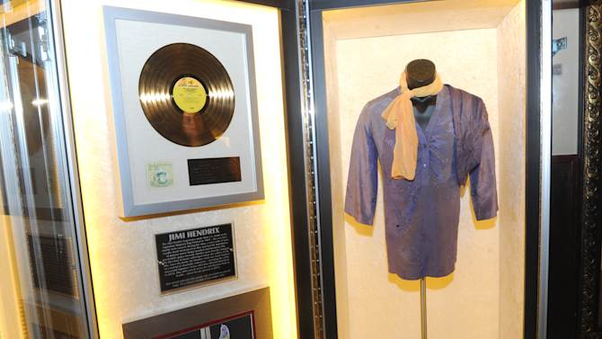 """A purple silk shirt Jimi Hendrix wore on stage is displayed at the launch of Hard Rock International's traveling music memorabilia collection, """"Music Gives Back,"""" Wednesday, Feb. 13, 2013, at Hard Rock Cafe New York.   """"Music Gives Back"""" focuses on artists who have worked with Hard Rock on charitable campaigns  and will be on tour at Hard Rock locations in the U.S. throughout 2013. (Photo by Diane Bondareff/Invision for Hard Rock International/AP Images)"""