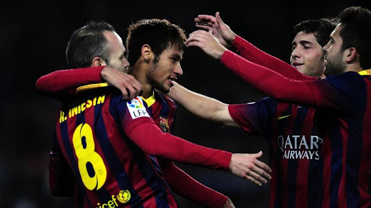 FC Barcelona's Neymar, from Brazil, second left, reacts after scoring with his teammate Andres Iniesta, left, against Cartagena during a Copa del Rey soccer match at the Camp Nou stadium in Barcelona, Spain, Tuesday, Dec. 17, 2013. (AP Photo/Manu Fernandez)
