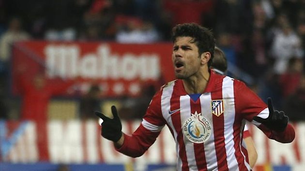 Atletico Madrid's Diego Costa celebrates after scoring his second goal from the penalty spot against Valencia during their Spanish first division soccer match at Vicente Calderon stadium in Madrid December 15, 2013 (Reuters)