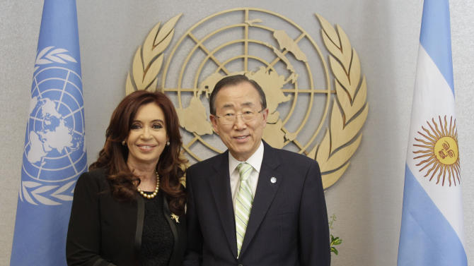 Agentina's President Cristina Fernandez de Kirchner, left, meets United Nations Secretary-General Ban Ki-moon,  Thursday, June 14, 2012 at United Nations headquarters. Argentina's president is pressing her country's claim to the Falkland Islands with a high-profile appearance Thursday before a little-known U.N. committee on the 30th anniversary of Britain's ouster of an Argentine invasion force. (AP Photo/Mary Altaffer)