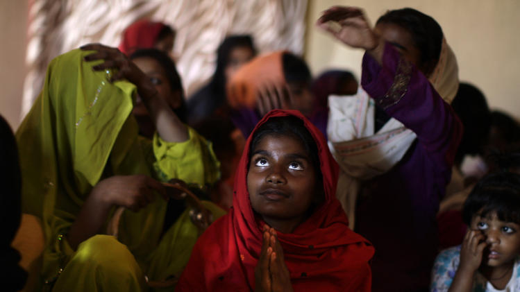 Pakistani Christians pray during a Mass on Good Friday in a church in Islamabad, Pakistan, Friday, March 29, 2013. Christians around the world are marking the Easter holy week. (AP Photo/Muhammed Muheisen)