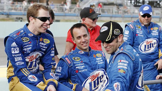 Brad Keselowski talks to his crew members before the NASCAR Sprint Cup Series auto race at Homestead-Miami Speedway, Sunday, Nov. 18, 2012, in Homestead, Fla. (AP Photo/The Miami Herald, Andrew Uloza)  MAGS OUT