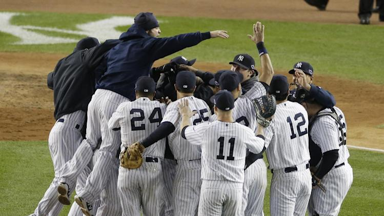 The New York Yankees celebrate after winning the American League division baseball series after beating the Baltimore Orioles 3-1 in Game 5 on Friday, Oct. 12, 2012, in New York. (AP Photo/Peter Morgan)