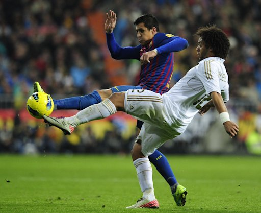 "Barcelona's Chiliean forward Alexis Sanchez  (L) vies with Real Madrid's Brazilian defender Marcelo  (R) during the ""El clasico"" Spanish League football match Real Madrid against Barcelona at the Santiago Bernabeu stadium in Madrid on December 10, 2011.   AFP PHOTO/JAVIER SORIANO (Photo credit should read JAVIER SORIANO/AFP/Getty Images)"
