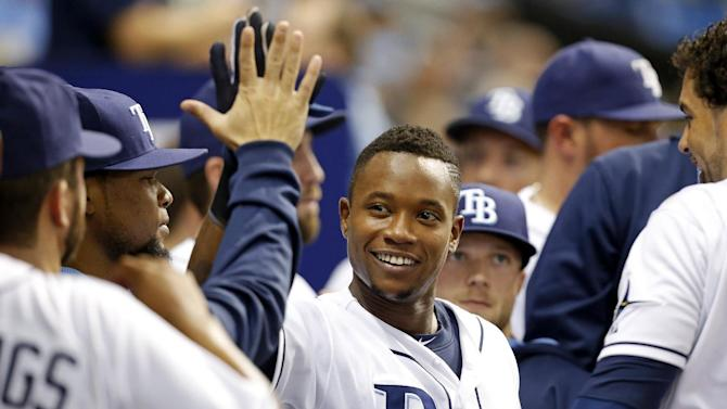 Tampa Bay Rays' Tim Beckham is congratulated by teammates after hitting a two-run home run during the seventh inning of a baseball game against the Toronto Blue Jays Friday, April 24, 2015, in St. Petersburg, Fla. (AP Photo/Mike Carlson)