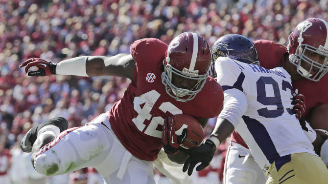 Alabama running back Eddie Lacy (42) scores on a 7 yard touchdown run as Western Carolina defensive lineman Caleb Hawkins (93) defends during the first half of an NCAA college football game at Bryant-Denny Stadium in Tuscaloosa, Ala., Saturday, Nov. 17, 2012. (AP Photo/Dave Martin)