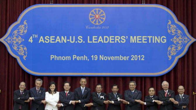 U.S. President Barack Obama, fifth from left, stands hand in hand with ASEAN leaders for a family photo during the ASEAN-U.S. leaders' meeting at the Peace Palace in Phnom Penh, Cambodia, Monday, Nov. 19, 2012. They are, from left, Philippines' President Benigno Aquino III, Singapore's Prime Minister Lee Hsien Loong, Thailand's Prime Minister Yingluck Shinawatra, Vietnam's Prime Minister Nguyen Tan Dung, Obama, Cambodia's Prime Minister Hun Sen, Brunei's Sultan Hassanal Bolkiah, Indonesia's President Susilo Bambang Yudhoyono, Laos Prime Minister Thongsing Thammavong, Malaysia's Prime Minister Najib Razak and Myanmar's President Thein Sein. (AP Photo/Carolyn Kaster)