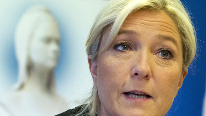 French far-right National Front party leader Marine Le Pen speaks during a meeting at their headquarters in Nanterre, west of Paris, Tuesday, May 27, 2014. The anti-EU, anti-immigration National Front party shook France's political landscape by coming out on top in France's voting for European Parliament elections, beating the mainstream conservatives and the governing Socialists. (AP Photo/Jacques Brinon)