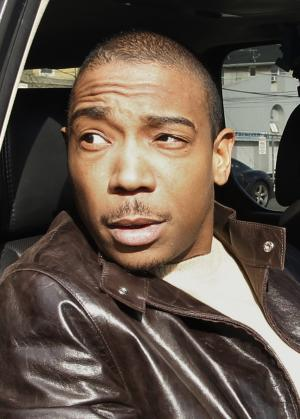 FILE - In this March 22, 2011 file photo, Rapper Ja Rule, left, is shown outside Martin Luther King, Jr. Courthouse after pleading guilty to federal tax evasion charges in Newark, N.J. Ja Rule was sentenced Monday, July 18, 2011 to more than two years in federal prison for failing to file income tax returns, and said a combination of youthful inexperience, bad advice and an inability to manage fame and fortune lead to his financial troubles.  (AP Photo/Julio Cortez, file)