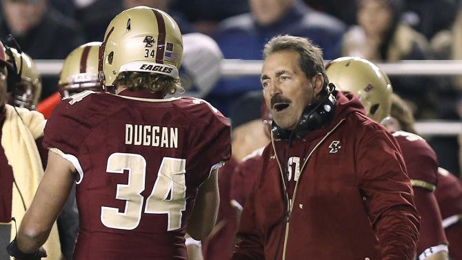 Boston College head coach Frank Spaziani talks with linebacker Sean Duggan during the first half of an NCAA college football game against Notre Dame in Boston on Saturday, Nov. 10, 2012. (AP Photo/Winslow Townson)
