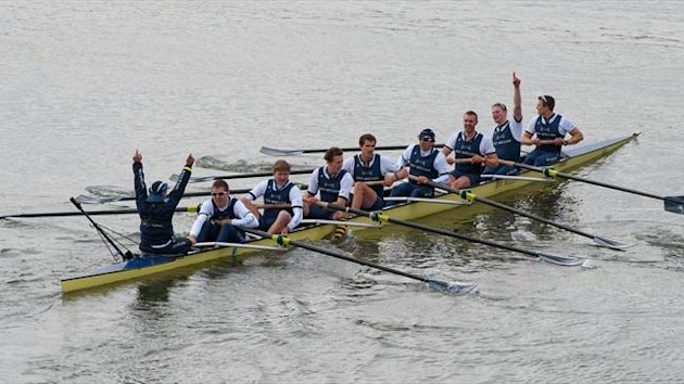 The Oxford University boat crew celebrate after crossing the finish line to beat the Cambridge University crew during the annual boat race on the River Thames in London on March 31, 2013 (AFP)