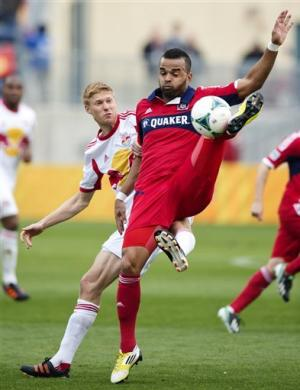 Santos scores twice to lead Fire over Red Bulls