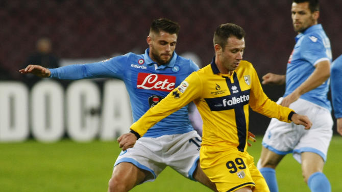 Parma's Italian forward Antonio Cassano (R) fights for the ball with Napoli's Spanish midfielder David Lopez during the Italian Serie A football match on December 18, 2014 at the San Paolo stadium in Naples